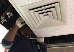CTS Technician Completing Service of HVAC